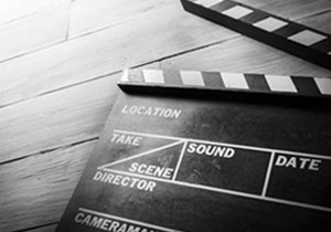 Black and white photo of a clapperboard used in filmmaking